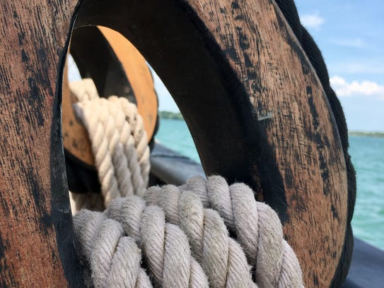 Ropes are secured through wooden loops on the deck