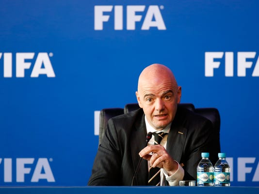 FIFA President Gianni Infantino speaks during a press conference after the FIFA Council Meeting, in Bogota, Colombia, Friday, March, 16, 2018. FIFA has finally and fully approved video review to help referees at the World Cup. The last step toward giving match officials high-tech help in Russia was agreed to on Friday by FIFA's ruling council chaired by Infantino. (AP Photo/Fernando Vergara)