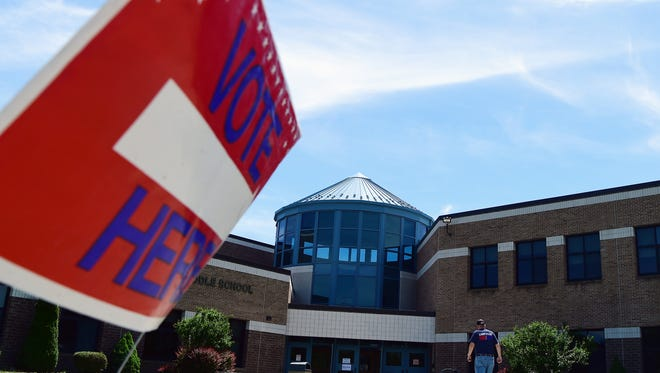 Voters at Owego Appalachian Middle School cast votes in New York's Democratic Congressional Primary. The winner of the NY-23 primary will face Republican Rep. Tom Reed in November.