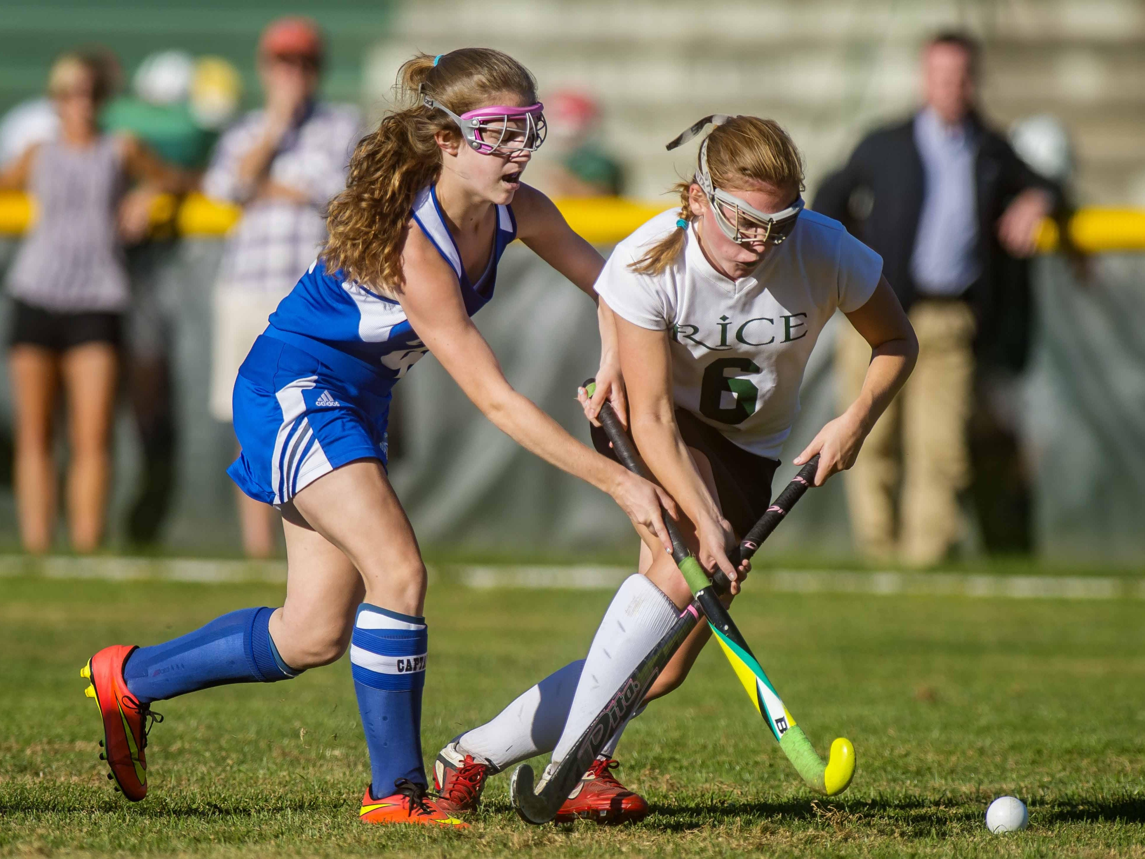 Rice's Clare Sheanan, right, keeps the ball away from Colchester's Katina Messier in South Burlington on Tuesday.