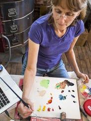 Wendy James works in her shared studio on Howard Street