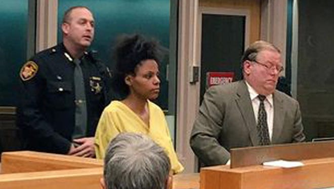 De'asia Watkins appears before a judge March 20, 2015, after being accused of beheading her 3-month-old daughter.