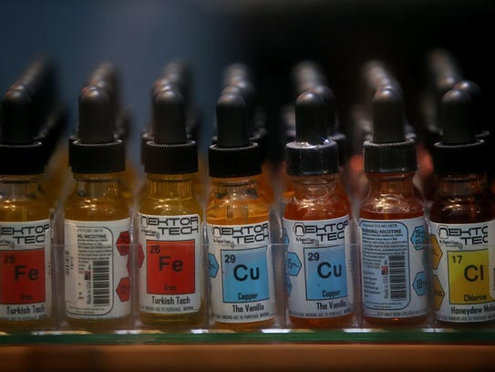Bottles of liquid used in e-cigarettes are displayed