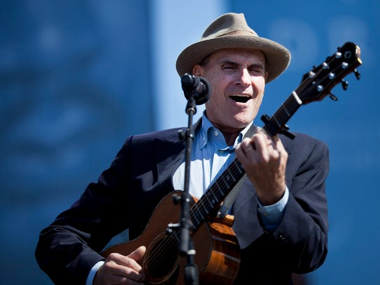 James Taylor performs during a dedication ceremony