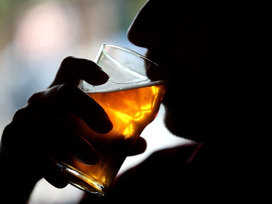 File photo of someone drinking a beer.