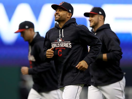 Coco Crisp (center) was recently hired to coach baseball