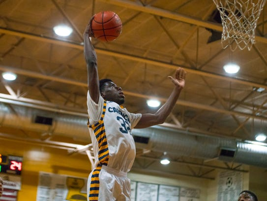 Carencro's Lou Despanie skies for a dunk during the Golden Bears' 55-40 win over Salmen in the Class 4A state regionals.