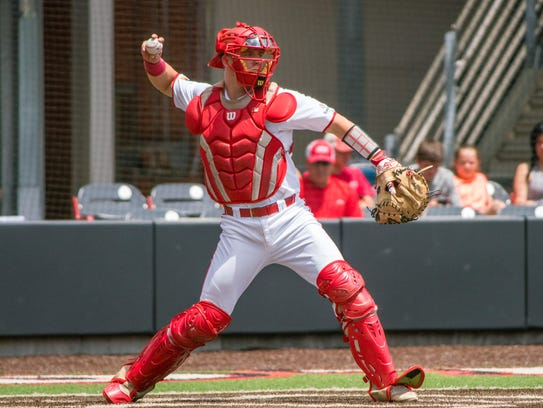 UL's Kole McKinnon, who has caught in every game this season, throws to second against Little Rock last weekend.