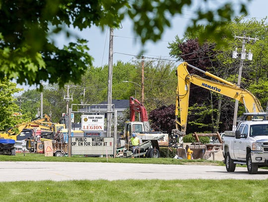 Crews work on road construction along Fond du Lac Avenue in Fond du Lac Wednesday May 23, 2018. Doug Raflik/USA TODAY NETWORK-Wisconsin