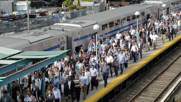 Long Island Rail Road commuters arrive at the Hunterspoint