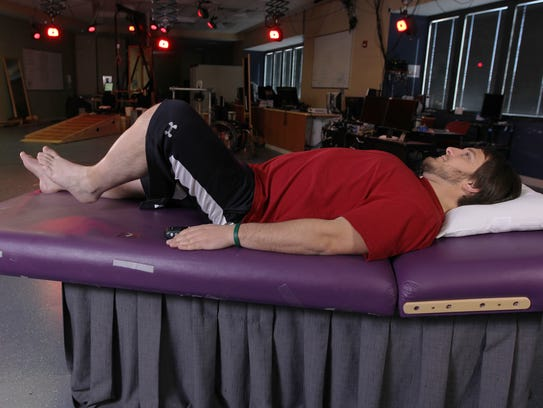 In this undated photo provided by the University of Louisville, Kent Stephenson, the second person to undergo epidural stimulation of the spinal cord, voluntarily raises his leg while stimulated at the Human Locomotion Research Center laboratory, a part of the University of Louisville?s Kentucky Spinal Cord Injury Research Center, Frazier Rehab Institute, in Louisville Ky. Three years ago, doctors reported that zapping a paralyzed man?s spinal cord with electricity allowed him to stand and move his legs. Now they?ve done the same with three more patients, suggesting their original success was no fluke. (AP Photo/University of Louisville)