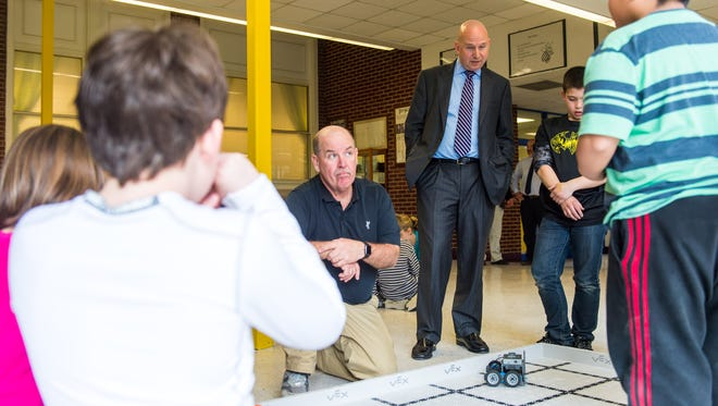Governor Jack Markell observes students working with robotic cars at Georgetown Elementary on Thursday, March 3 in Georgetown.