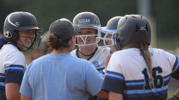 Enka coach Jennifer Kruk meets with some of her players during Wednesday's 7-3 win over West Iredell in Candler.