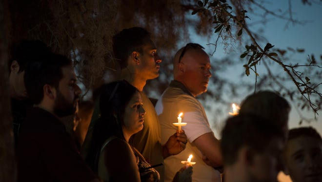 A candlelight vigil was held Thursday evening, Feb. 15 at Pine Trails Park amphitheater, where thousands of students, parents and community members gathered to honor the lives of 17 people whose lives were taken in a shooting at Marjory Stoneman Douglas High School.