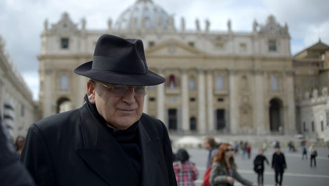 In this file picture, U.S. Cardinal Raymond Burke walks on St Peter's square after a cardinals' meeting on the eve of the start of a conclave in 2013 at the Vatican.