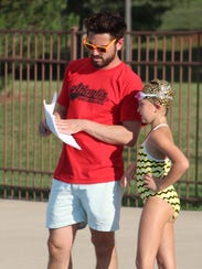 BBA head swim coach Johnny Austermann talks with Leah