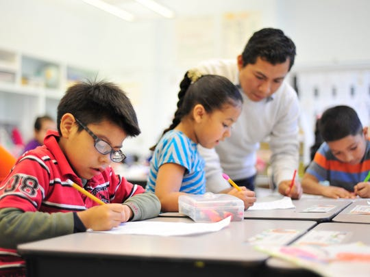 Francisco Victoria Guijon works on a writing exercise during a first grade ELL class at Richmond Elementary School in Salem on Tuesday, Dec. 16, 2014.