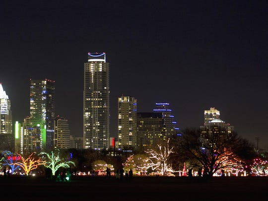FILE - This Dec. 16, 2012, file photo shows the skyline at night of Austin, Texas. Austin is one of the many cities vying to land Amazon's second headquarters. While Texas cities trying to land the new headquarters have been vocal about why they think they should win, they've resisted releasing copies of their proposals. (Jay Janner/Austin American-Statesman via AP, File)