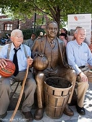 Jim Naismith (right) and cousin Stuart Naismith at the 2011 dedication of a sculpture of their grandfather, Dr. James Naismith, at the Naismith Museum in Almonte, Ontario, the elder Naismith's birthplace.