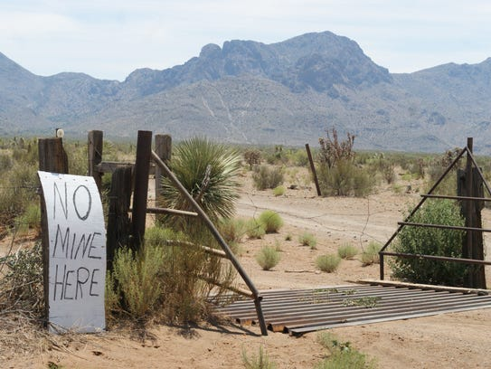 Signs expressing opposition to the mine dot Camino