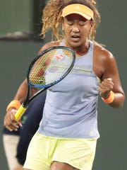 Naomi Osaka of Japan reacts to winning a point against