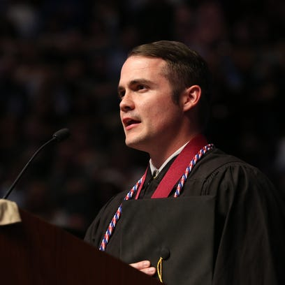 Ryan Taylor, a student-veteran, delivers the pledge