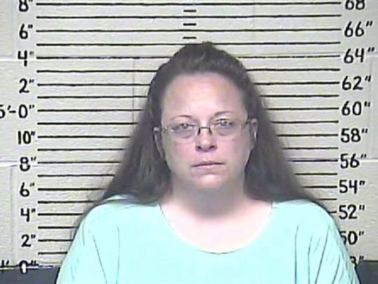 This Aug. 3, 2015 photo made available by the Carter County Detention Center shows Kim Davis. The Rowan County, Ky. clerk went to jail for refusing to issue marriage licenses to gay couples, but five of her deputies agreed to comply with the law, ending a two-month standoff.