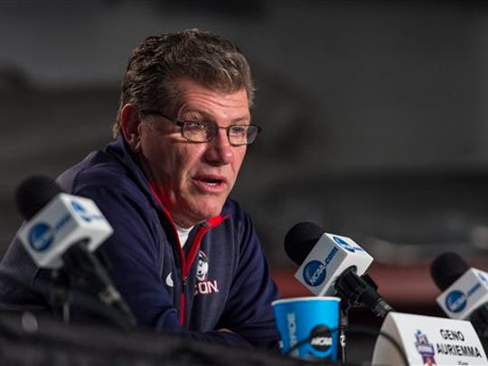 University of Connecticut women's basketball coach Geno Auriemma speaks during a news conference. Auriemma fired back at a Boston Globe columnist who said that his team's domination of competition is wrecking the women's college game.