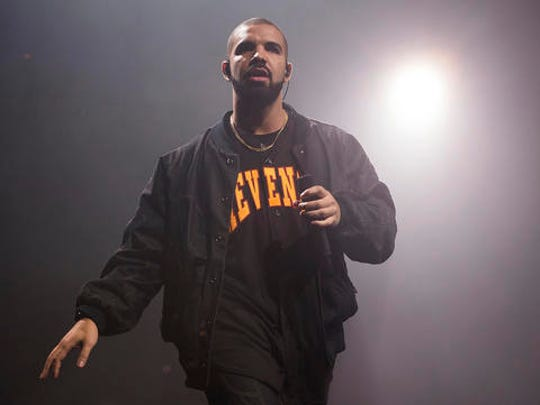 FILE - In this Aug. 5, 2016, file photo, Drake performs in concert as part of the Summer Sixteen Tour in New York. Photos and videos posted online Dec. 30, 2016 of Drake dancing with and kissing Jennifer Lopez has prompted internet speculation of a duet or romance between the two.