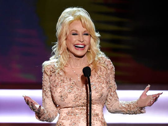 FILE - In this Jan. 29, 2017, file photo, Dolly Parton presents the Lifetime Achievement Award at the 23rd annual Screen Actors Guild Awards at the Shrine Auditorium & Expo Hall in Los Angeles. Parton's My People Fund has issued monthly checks to hundreds of people who lost their homes in deadly wildfires that ravaged East Tennessee in 2016.