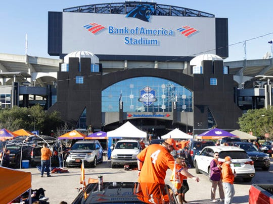 "FILE - In this Dec. 5, 2015, file photo, Clemson fans tailgate outside of Bank of America Stadium prior to the Atlantic Coast Conference championship NCAA college football game between North Carolina and Clemson in Charlotte, N.C.  The NCAA says it will consider North Carolina as a host for championship events again after the state rolled back a law that limited protections for LGBT people. In a statement Tuesday, April 4, 2017, the governing body said its Board of Governors had reviewed moves to repeal repealed the so-called ""bathroom bill"" and replace it with a compromise law."