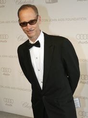Director John Waters arrives at the 15th annual Elton