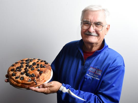 Rick Mines displays Grape Bread, made by his wife,