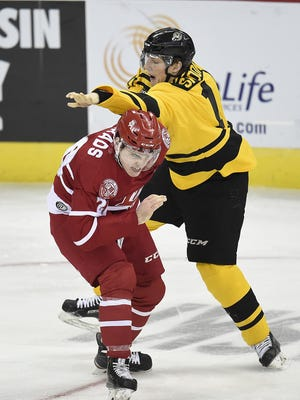 Green Bay Gamblers forward Jared Spooner gets into a fight with Dubuque Fighting Saints forward Dallas Gerads during Wednesday night's USHL hockey game at the Resch Center in Ashwaubenon.
