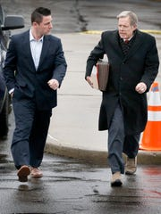 Thomas Clayton, left, talks with his lawyer, Ray Schlather, as they walk into the Steuben County Courthouse on Thursday. Clayton pleaded not guilty to murder charges stemming from his wife's death on Sept. 29 in their Caton home.