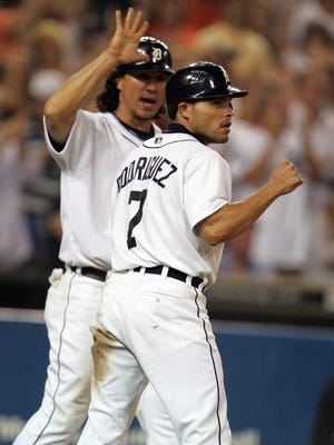 Detroit Tigers' Ivan Rodriguez celebrates with Magglio Ordonez during a game September 21, 2007.