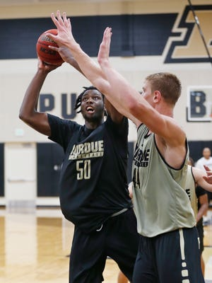 Caleb Swanigan with a shot over Isaac Haas during Purdue men's basketball practice Tuesday, July 26, 2017, on Cardinal Court.