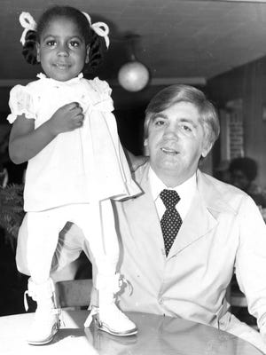 Former McNairy County Sheriff Buford Pusser, right, with West Tennessee Easter Seal poster child Cissy Cole  Date on back of photo: March 6, 1974