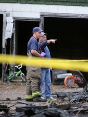 Firefighters inspect the scene of a fatal house fire in Martin, Tenn., on Monday, Jan. 2, 2017.
