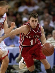 North Carolina State's Archie Miller  (11) races past Maryland's Steve Blake in the final minutes of the ACC  Men's Basketball Tournament semifinal March 9, 2002, in Charlotte, N.C.