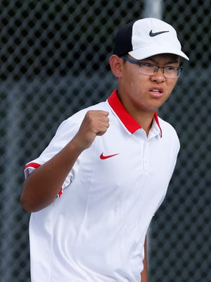 West Lafayette's Benny Zhang pumps his fist after securing a point as he and Addison Jordan battle Harrison's Eli and Jake Webb at No. 2 doubles Thursday, August 17, 2017, at Harrison High School. Zhang and Jordan won 7-5, 6-3. West Lafayette won the match 4-1.
