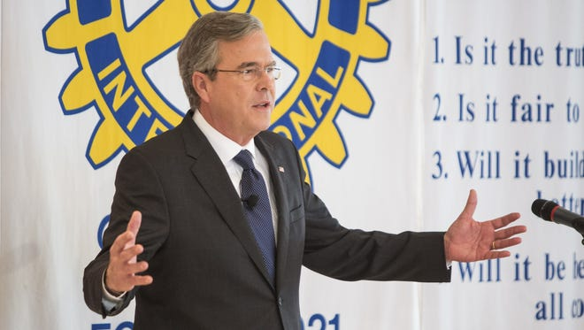 Republican presidential candidate Jeb Bush talks to Rotarians and their guests during a luncheon Monday in Nashua, N.H.