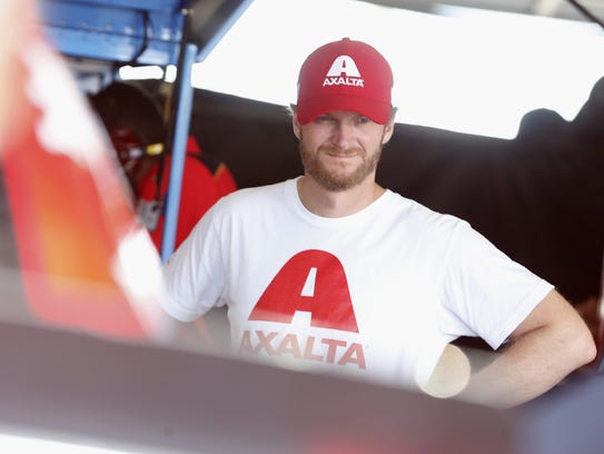 Dale Earnhardt, Jr. stands in the garage during practice