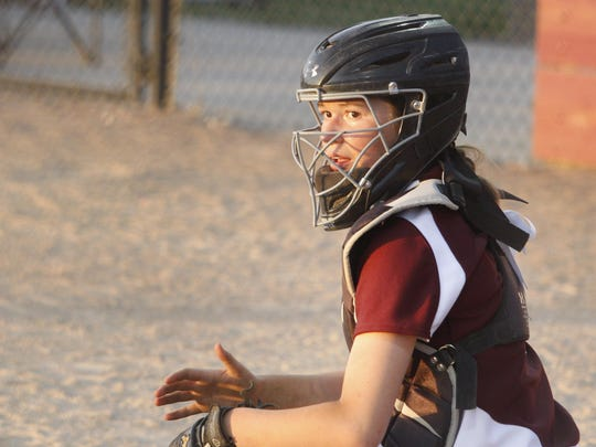 Ankeny catcher Mya Mathes looks for a signal from the dugout during the second game of a doubleheader against visiting Southeast Polk on June 5. The Rams swept the twinbill by scores of 9-3 and 15-5.