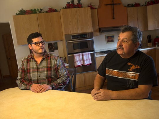 Timothy Martinez, left, and his father Timmy Martinez talk about their plans to open the Rio Suave Vineyards on Wednesday at their home in Blanco.