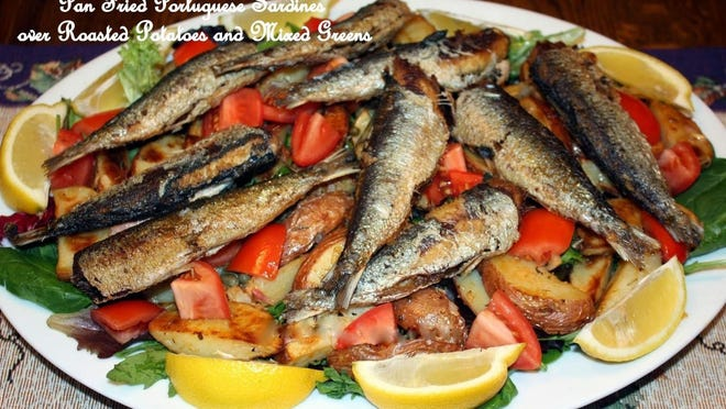 Pan-Fried Portuguese Sardines over Roasted Red Potatoes and Mixed Salad Greens.