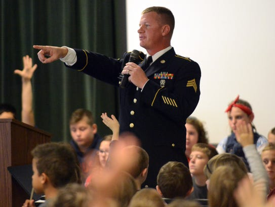 Ohio Army National Guard Sgt. Thomas Crapps points