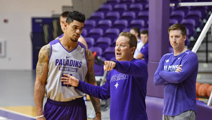 Furman's Kris Acox, left, receives instruction from basketball coach Niko Medved during practice Friday.
