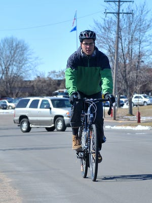 A cyclist rides along Lake View Drive in Wausau.
