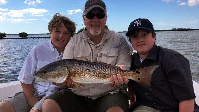 Scott Johnson and sons Branden and Davis were the picture of a happy family after this nice keeper redfish picked off a live pinfish near Starvation Key in Estero Bay last Wednesday with Get Hooked Charter Capt. Matt DeAngelis.